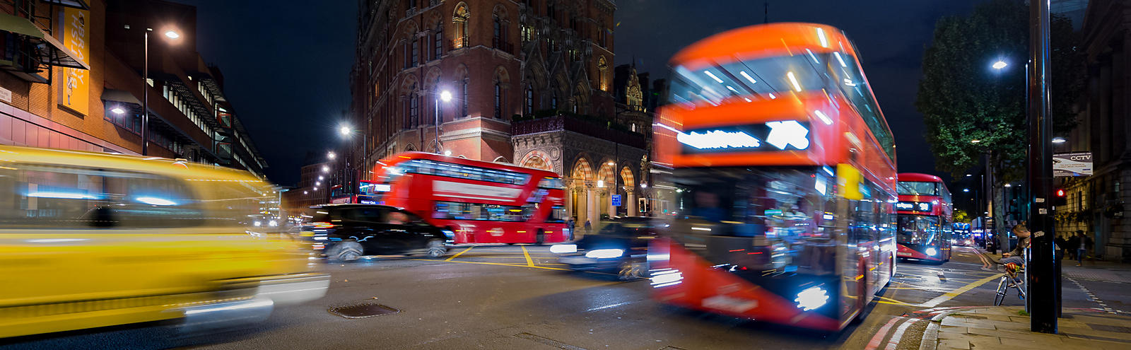 Busy London Traffic at Night with St Pancras Station Hotel