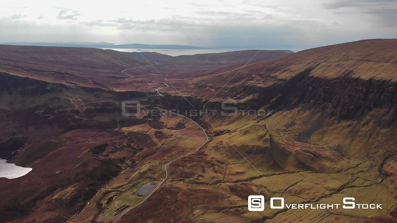 Aerial drone shot a road going by Quiraing, Isle of Skye, Scotland