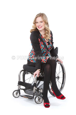 Women in wheelchairs at a fashion shoot