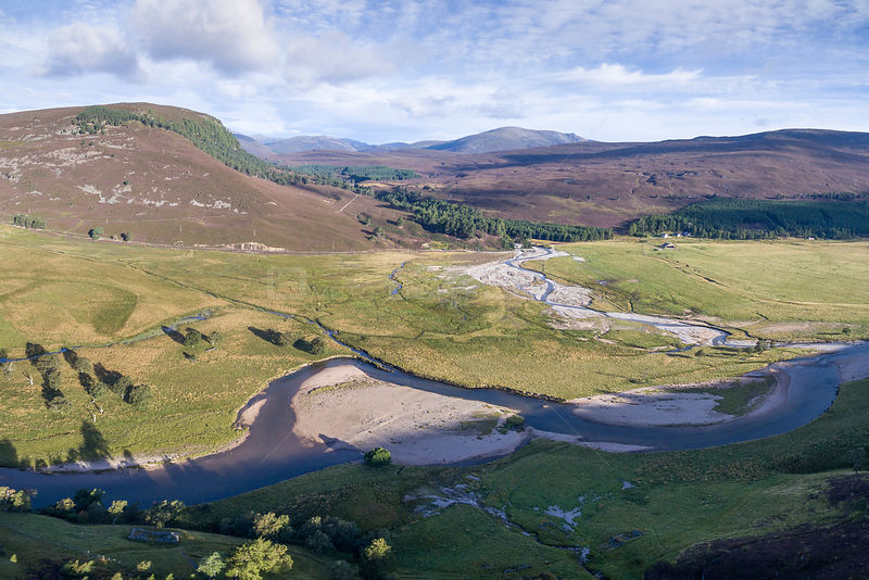 Aerial view of River Dee with some riparian vegetation flowing through moorland, Deeside, Cairngorms National Park, Scotland,...