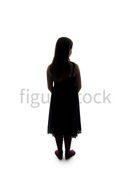A Figurestock image of a girl in silhouette, standing, looking forward – shot from eye level.
