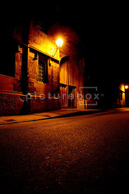 An atmospheric image of an Big, old door at night, Oxford England.