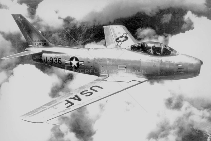 KOREA -- 1950s -- An F-86 Sabre jet fighter in the skies over Korea. This was the first swept-wing fighter in the USAF