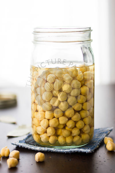 Chickpeas soaking in a jar