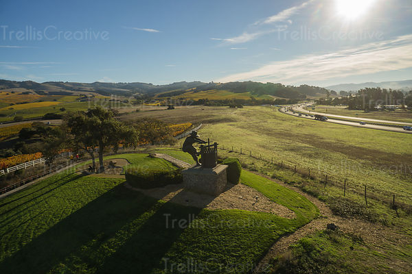 Aerial view of the Grape Crusher statue against the autumn sky
