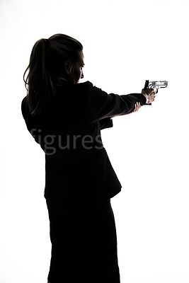 A silhouette of a woman in a suit, pointing a gun – shot from eye level.