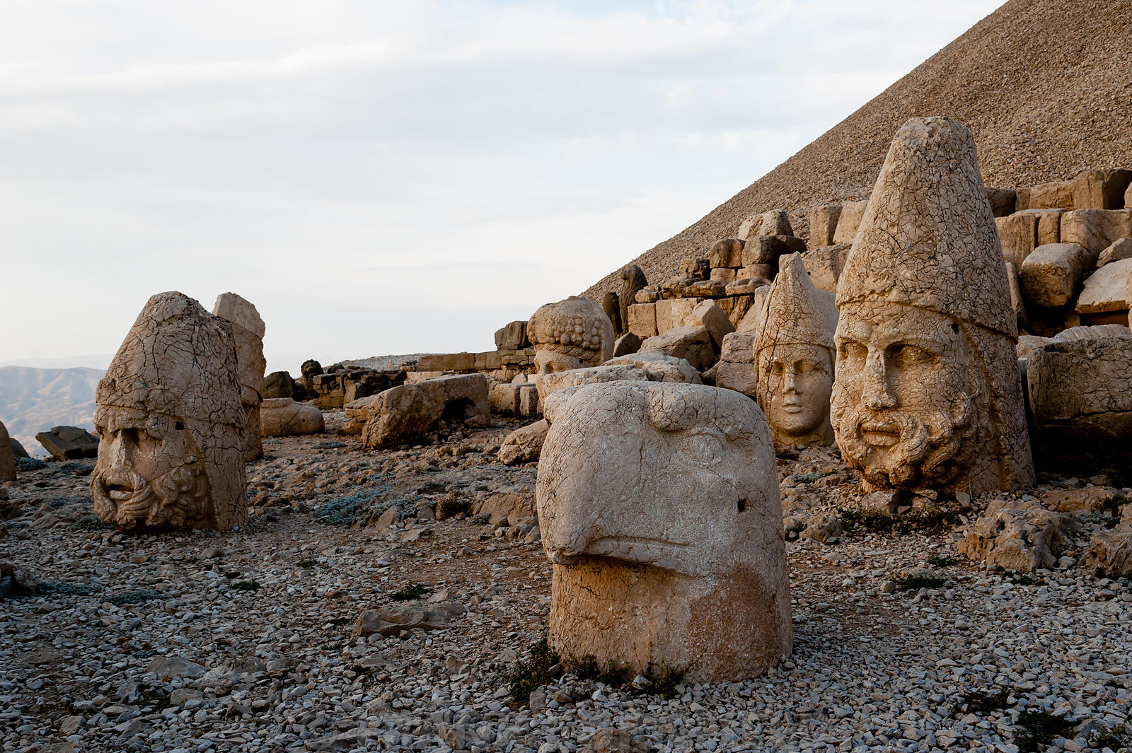 The west terrace of Mount Nemrut with heads of the colossal statues and the tumulus.  Heads of Zeus-Oromasdes, Commagene, Apo...