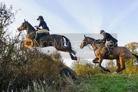 Boogie Machin jumping a hedge on line 3