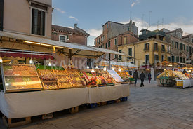 VENICE, ITALY - OCTOBER 31, 2018: Fruit and vegetable market stalls in street market in central Venice, Italy.