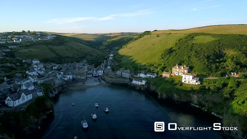 Drone descends to harbor wall of Port Isaac in Cornwall with beautiful morning light