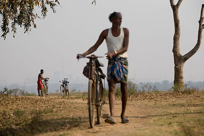India - Orissa - Men wait on the main road into Chandia Village