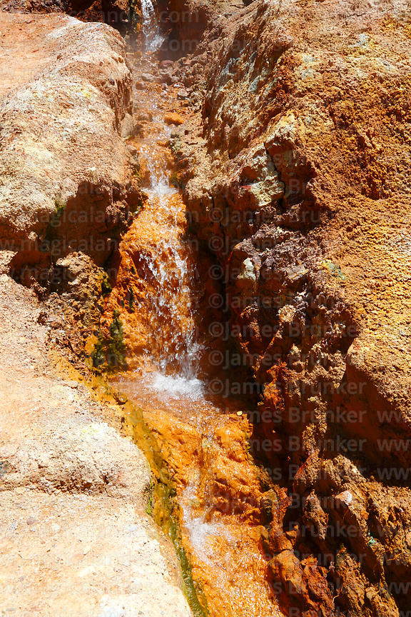 Mineral stained hot stream at Termas de Jurasi hot springs near Putre, Region XV, Chile