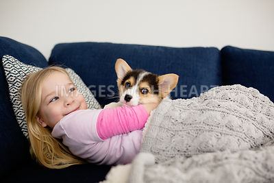 Girl_puppy_snuggling_inside