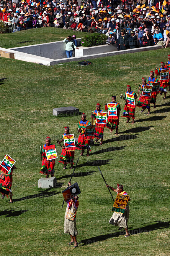 Warriors parade on lawn in front of Coricancha / Sun Temple at start of Inti Raymi festival, Cusco, Peru