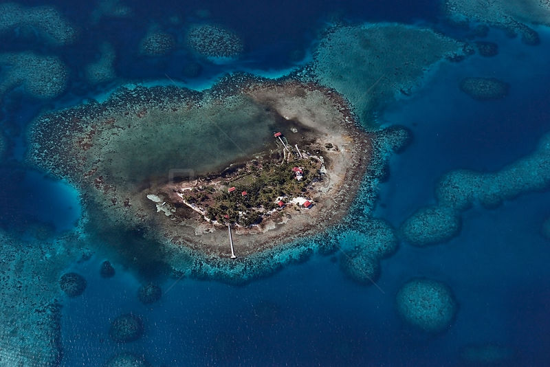 Aerial view of an inhabited coral cay inside the southern Belize barrier reef, off Placencia, Stann Creek District, Belize Ba...