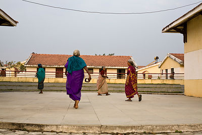 India - Cuddalore - Elders walk through the amphitheatre after morning worship