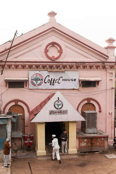 India - Allahabad - A man speaks to a waiter as he enters the Indian Coffee House while another spits onto the ground