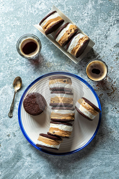 Vanilla and chocolate ice cream sandwiches on a plate