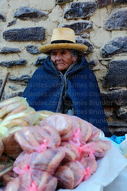 Old Quechua lady selling bread, Ollantaytambo, Sacred Valley, Peru