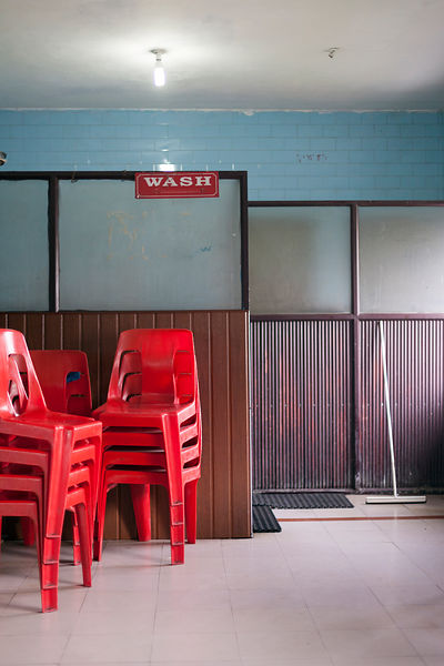 India - Ernakulam - Stacked red chairs in the Indian Coffee House