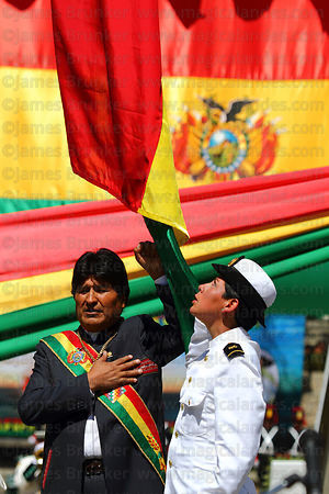 Bolivian president Evo Morales Ayma raises his left arm while singing the national anthem at start of official events for Dia...