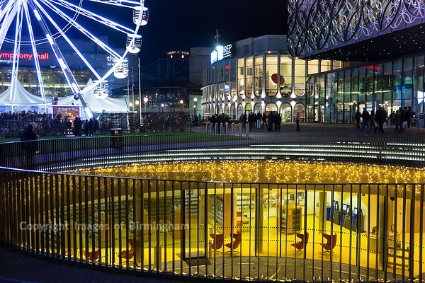 Christmas celebrations in Centenary Square, Birmingham. The big wheel outside of the Library of Birmingham.