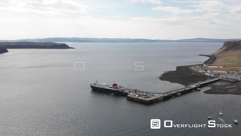 Aerial drone shot of a docked ferry on Isle of Skye, Scotland