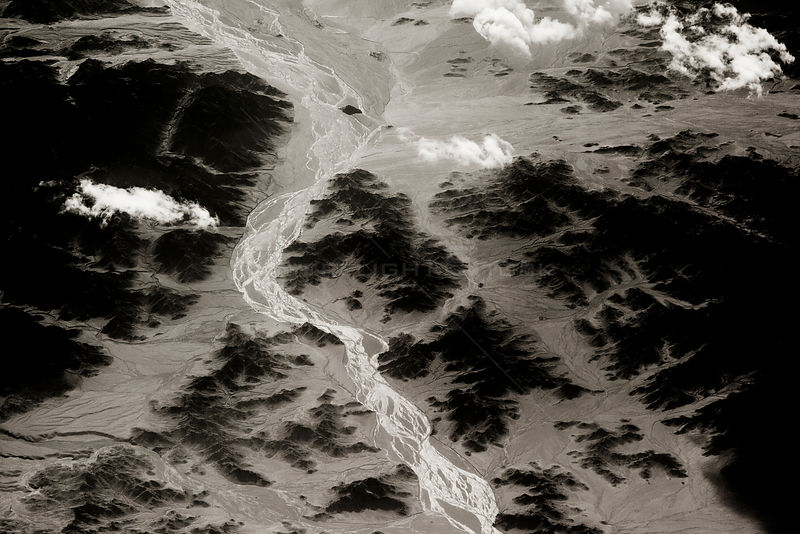 View from plane of rivers flowing through mountain valley, Saravan, South East Iran, December.