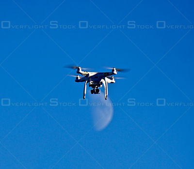 Drone in Flight Set Against a Moon