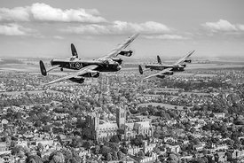 Lancs over Lincs: two Lancasters over Lincoln black and white version