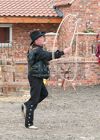 Man in Western gear doing Lasso tricks