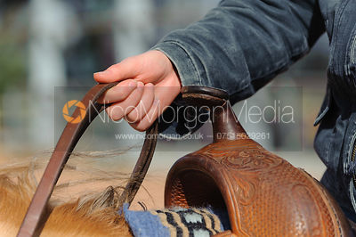 Stock photo of western rider holding reins