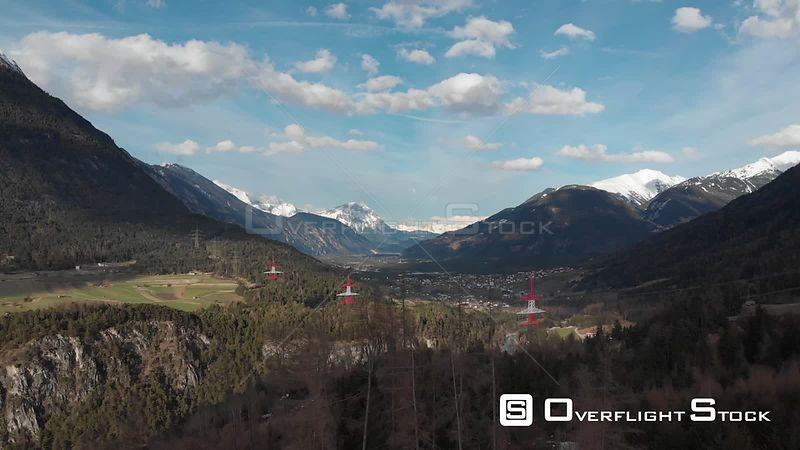 Aerial shot of Tyrolean Alps and villages in spring