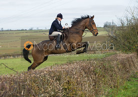 Kate Knowles jumping a hedge