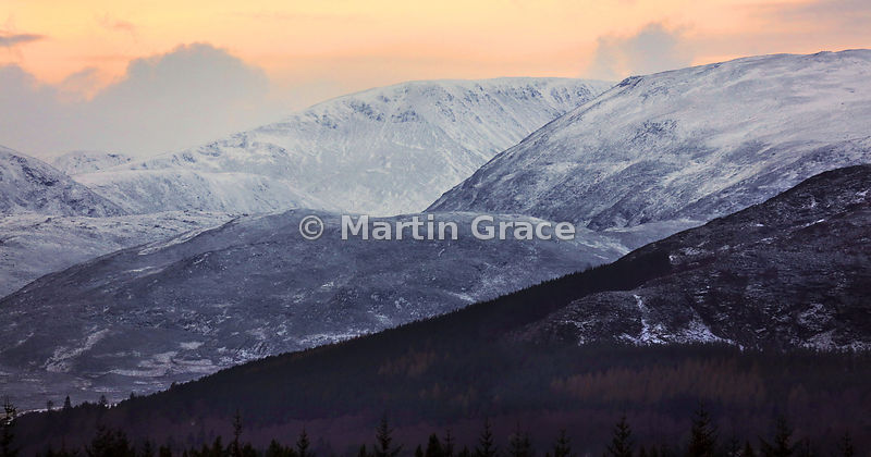 Carn Dearg with adjacent Monadhliath Mountains, dusted with snow in late afternoon on New Year's Day, Strathspey, Scottish Hi...