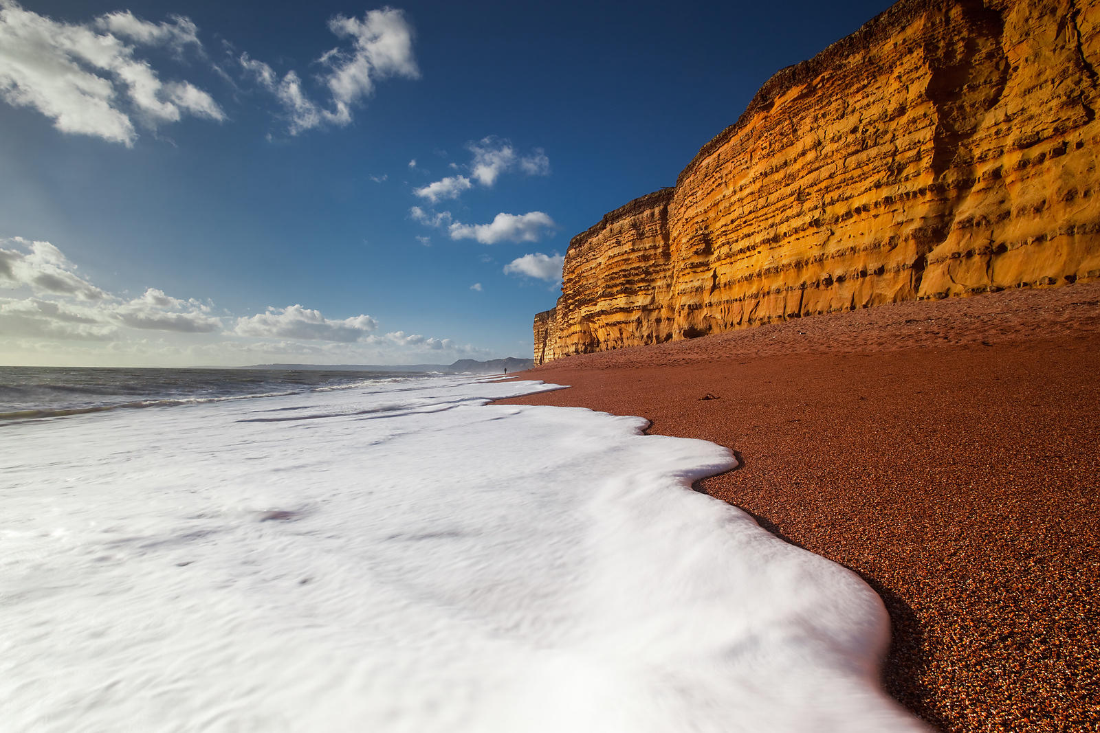 Foamy sea at Burton Bradstock