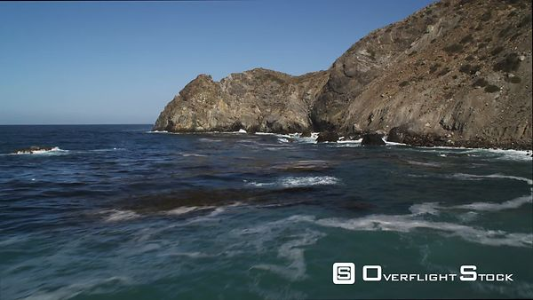 Flying Toward and Over a Coastal Cliff to Reveal More of Catalina's Rugged Coastline.