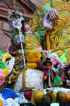 Toys on figure of San Jose , Corpus Christi festival , Cusco , Peru