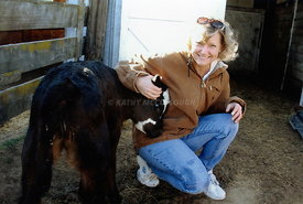 Lady with petting a calf