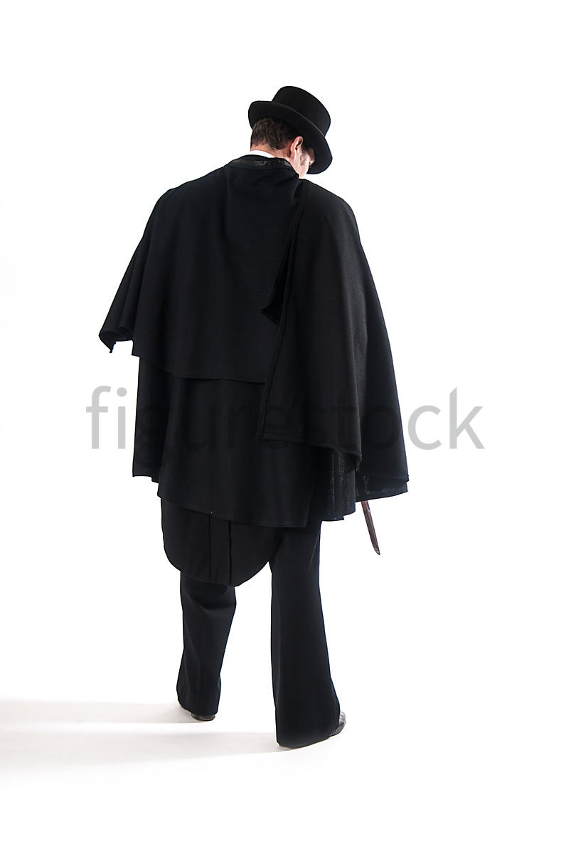 A Figurestock image of a Victorian man in a cloak, holding a knife - shot from eye level.