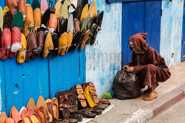 Shoe Seller Setting up his Display