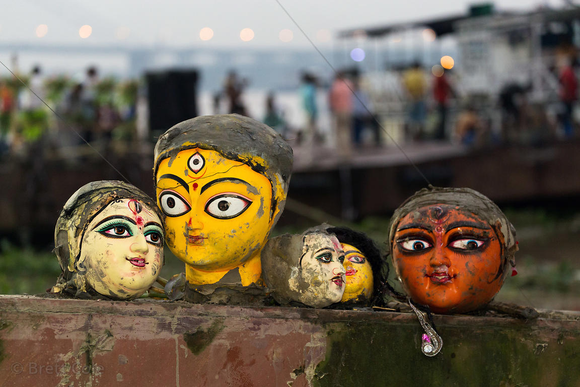 Painted ceramic heads from Hindu idols are reclaimed after being pulled from the Hooghly River, Babughat, Kolkata, India. The...