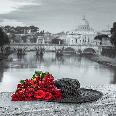 Bunch of roses with hat on bridge near Basilica di San Pietro in Vatican, Rome, Italy