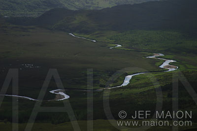 A river meanders and shines in the plains of South Connemara