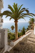 Spain, Andalusia, Malaga province, Nerja. street leading to the beach in the city center