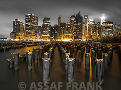 Evening shot of Lower Manhattan Skyline  with pier pilings in east river, New York, USA