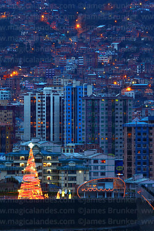Artificial Christmas tree at twilight with apartment blocks of Miraflores in background, La Paz, Bolivia