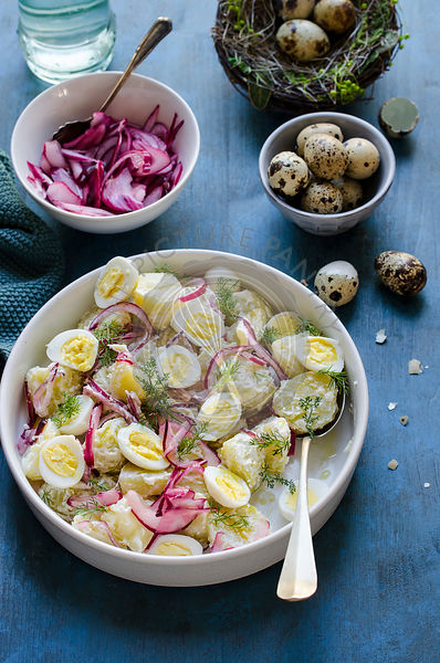 Potato and quail egg salad with pickled onions