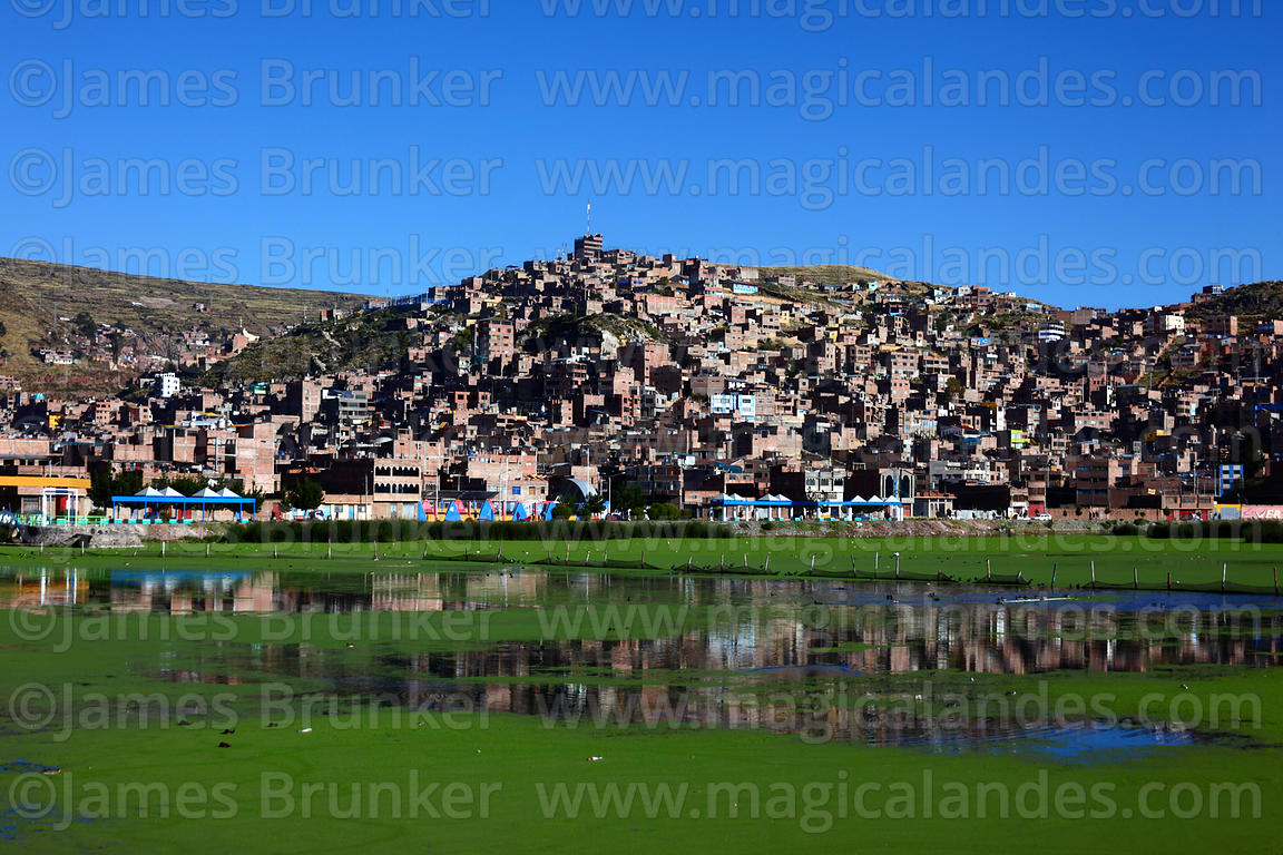 View across Lake Titicaca to Puno, Peru