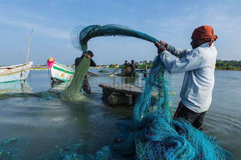 Fishermen Cleaning their Nets
